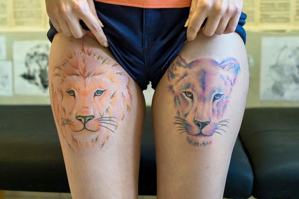 Lioness sitting tattoo